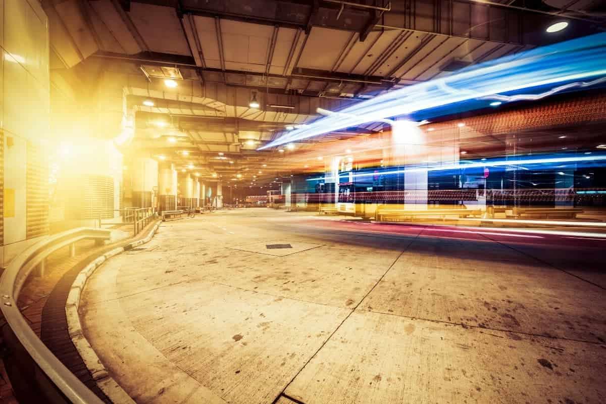 Car lights passing under tunnel