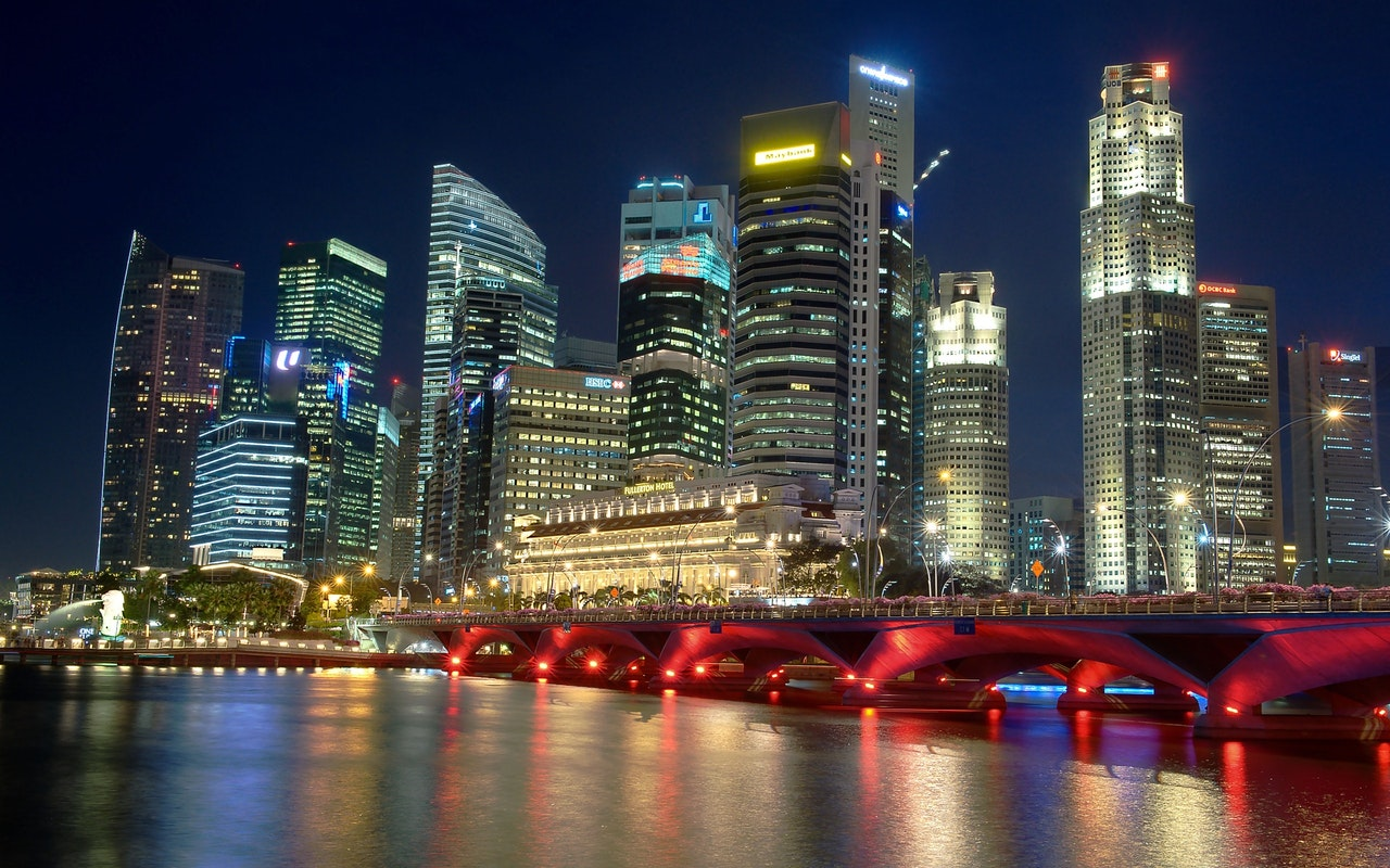City Skyscrapers Alongside River at Night