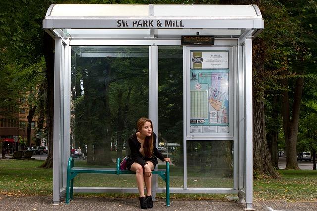 millennial waiting for bus